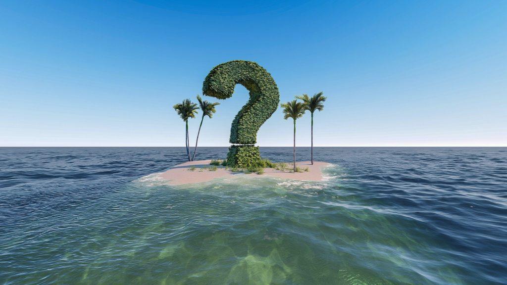 海の小島ににハテナマークの木が立っている画像